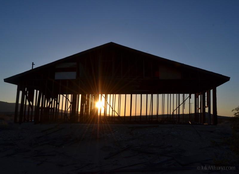 Desert sunset through frame of house