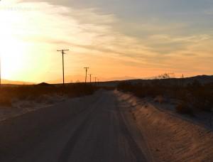 Desert road sunset sand power lines
