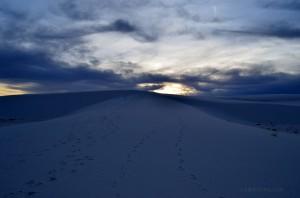 Footsteps in sand at sunset White Sands National Park
