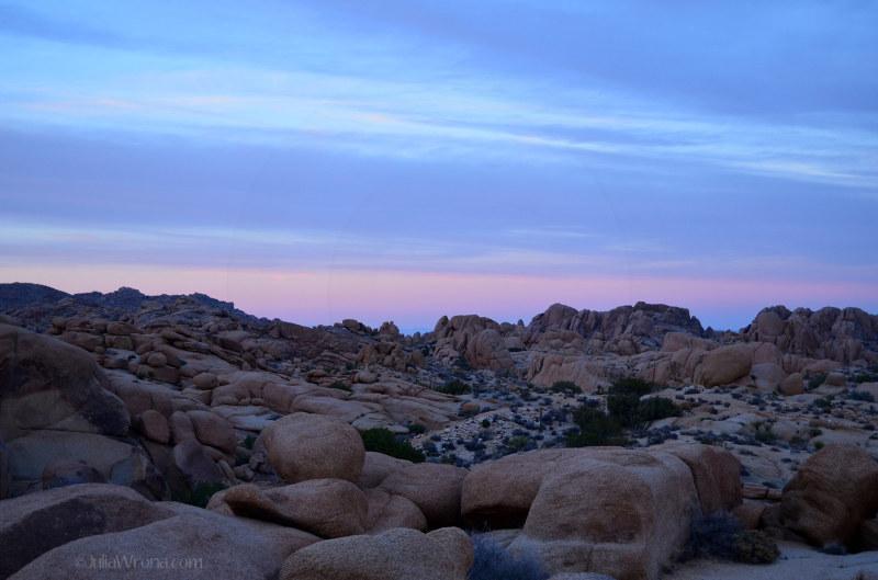 Sunset over boulder landscape in Joshua Tree
