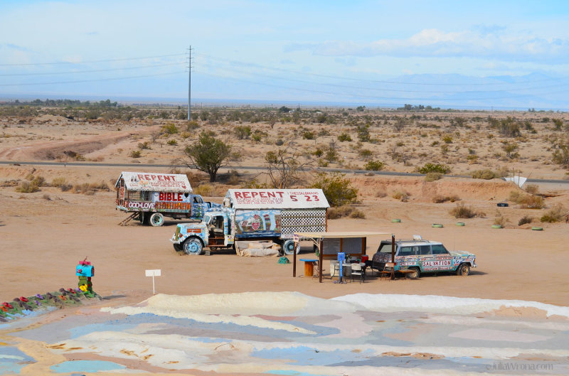 Wide shot of painted trucks at Salvation Mountain
