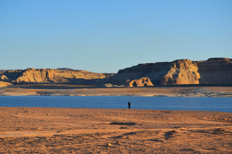 Man watching Sunrise over Lake Powell
