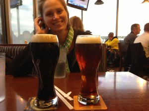 Julie with our beers at the Great Lakes brewery in the airport.
